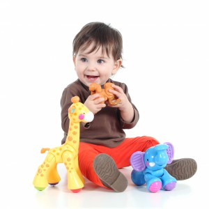 5517070-pretty-little-baby-girl-playing-with-animal-toys